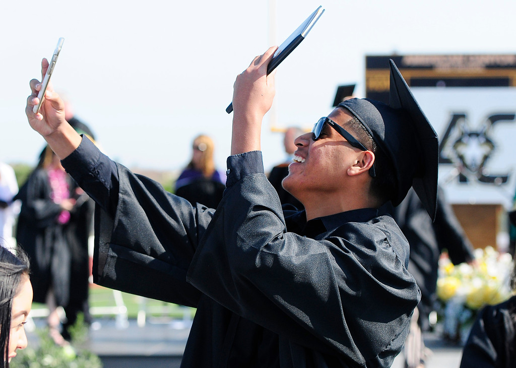 . AMERICAN CANYON, CA - JUNE 6, Nathaniel Aragon shows off his diploma on live video as he celebrates while graduating from American Canyon High School on Wednesday. (CHRIS RILEY/TIMES-HERALD)