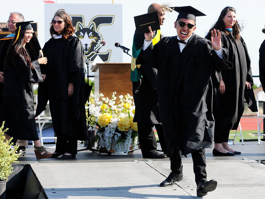 . (Chris Riley�Times-Herald) Dylan Rayala dances down the stage ramp afetr graduating with the American canyon High School class of 2018 on Wednesday.