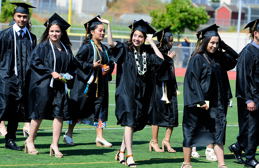 . AMERICAN CANYON, CA - JUNE 6, Graduates walk on to the football field during graduation at American Canyon High School on Wednesday. (CHRIS RILEY/TIMES-HERALD)