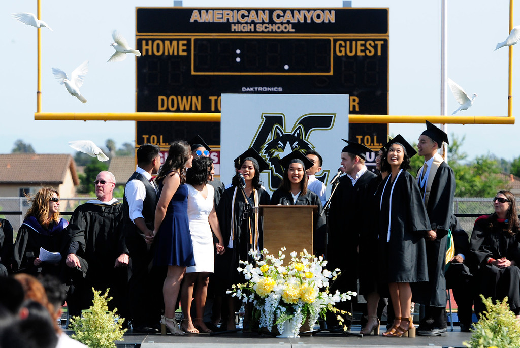 . AMERICAN CANYON, CA - JUNE 6, The ACHS choir, Public Display of A Capella, perform \'In My Life\' as birds are released during the American Canyon High School graduation on Wednesday. (CHRIS RILEY/TIMES-HERALD)