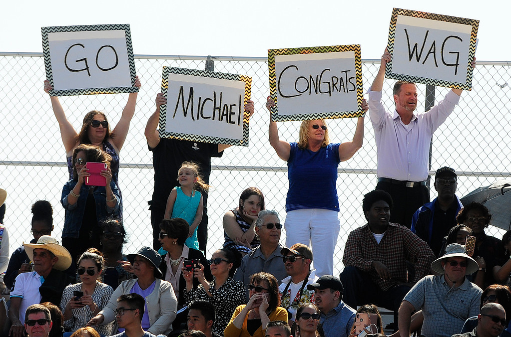 . AMERICAN CANYON, CA - JUNE 6, Family of Michael Wagaman hold up signs for him during graduation at American Canyon High School on Wednesday. (CHRIS RILEY/TIMES-HERALD)