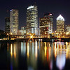 Tampa skyline view reflecting in the water of Tampa bay in November 2005. (AP Photo/Ron Williams)