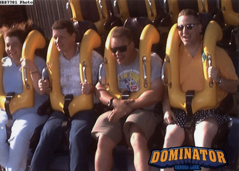 "Dominator, Geauga Lake: This is a B&M floorless that used to be called ""Batman - Knight Flight"" back when Six Flags owned the park. Since Six Flags sold the park to Cedar Fair, but retained several comic book/ride licenses, Geauga Lake recently had to rename several of their roller coasters, and this one is now ""Dominator"".<br /> <br /> In any case, here I am riding with Will during morning ERT."
