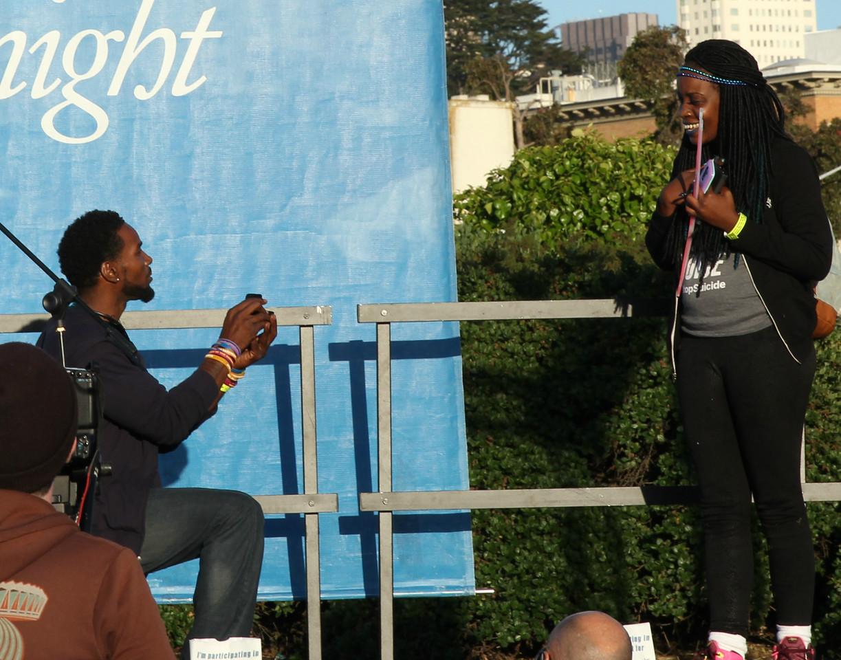 Kevin Berthia proposing to his girlfriend.