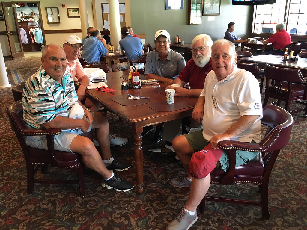 . Golfers enjoy scrambled eggs before heading out for the scramble.