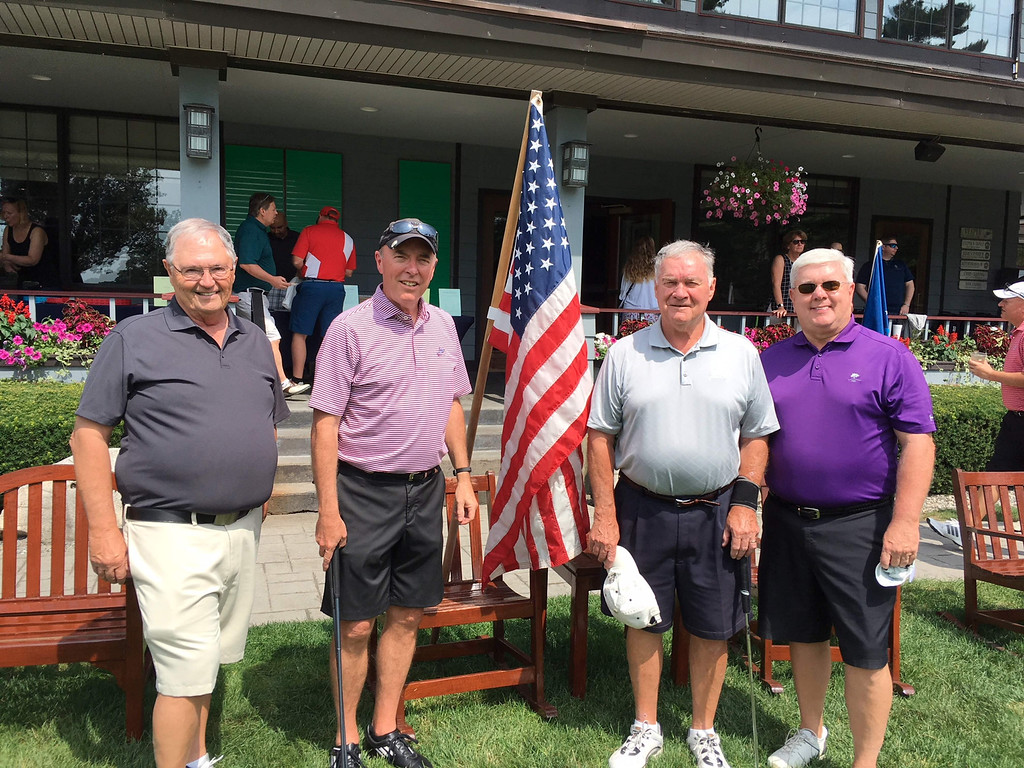 . From left, Rick Hansen of Hollis, N.H., Jim Cullen and Bill Gillette, both of Chelmsford, and Jim Shannon of Lowell