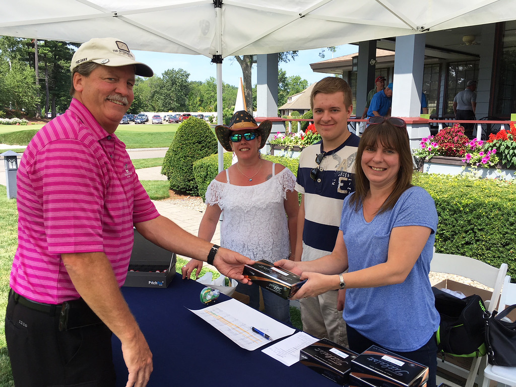 . From golfer Mike Robinson of Methuen with American Heroes committee members Kelly Pica of Plaistow, N.H., and Gus and Cheryl Trembley of Chester, N.H.