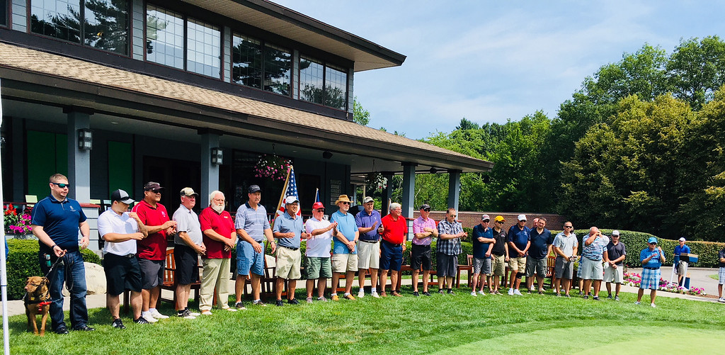 . Veterans are honored during the playing of �The Star-Spangled Banner.�