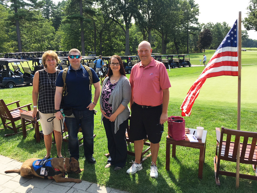 . From left, Trish O�Donnell of Lowell, Army veteran Jason Kopera with Dove, an Operation Delta Dog, Emily Clark of Manchester and Bob Provenzano of Woburn