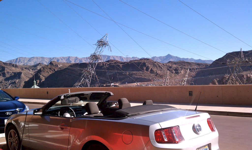 You can rent a Mustang convertible and drive to the dam yourself.