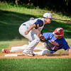 At left Lowell's American Legion player, Richard Glynn tags Natick's Noah Joseph out at third base. SUN/Caley McGuane