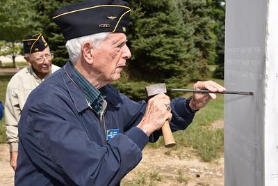 John Beglan Jr. incises a star for his father John L. Beglan.
