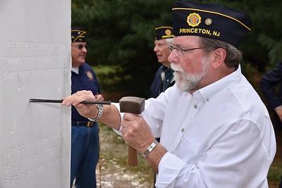 Joe Leone incises a star for Capt. Stephen A. Rusch, USAF.