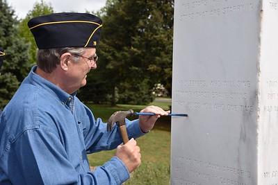 Michael Mc Mahon incises a star for his Father and American Legion member Joseph H. Mc Mahon