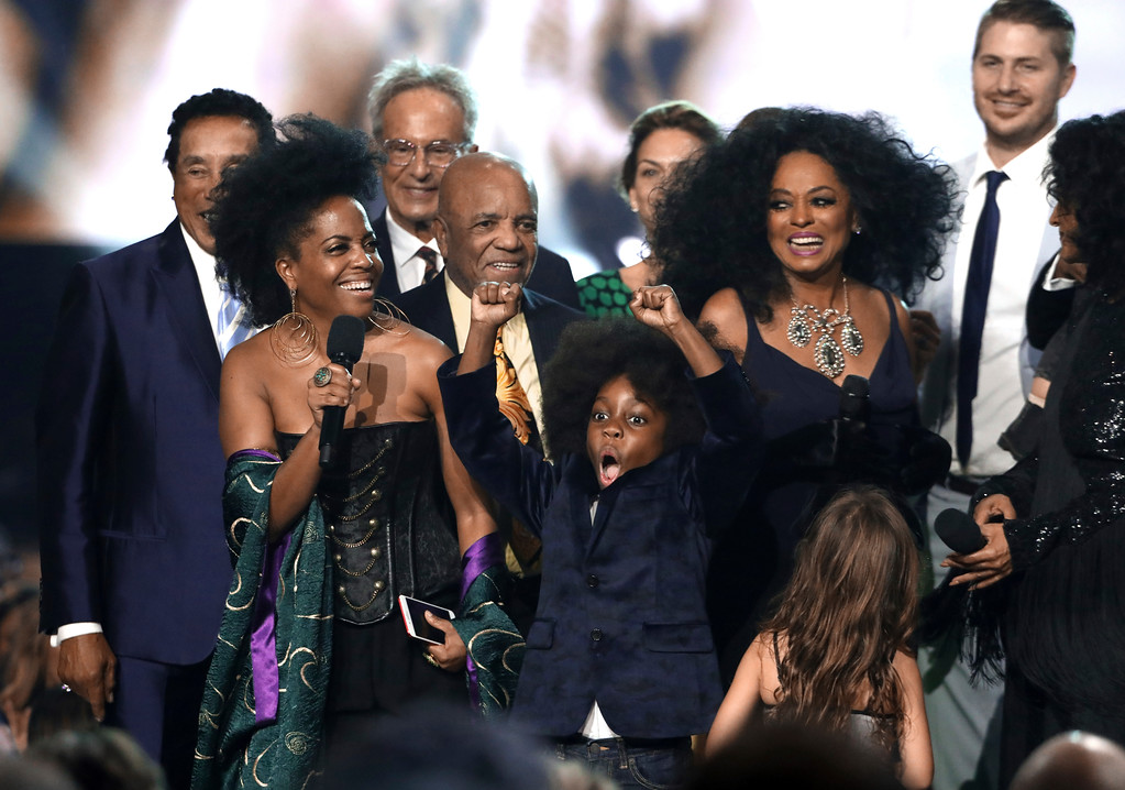 . Rhonda Ross Kendrick, from left, speaks and her son Raif-Henok Emmanuel Kendrick reacts as Diana Ross accepts the lifetime achievement award at the American Music Awards at the Microsoft Theater on Sunday, Nov. 19, 2017, in Los Angeles. (Photo by Matt Sayles/Invision/AP)