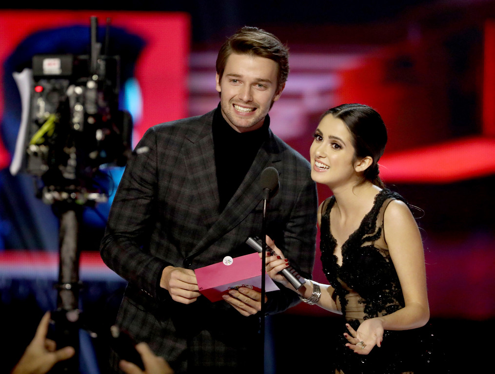 . Patrick Schwarzenegger, left, and Laura Marano present the award for collaboration of the year at the American Music Awards at the Microsoft Theater on Sunday, Nov. 19, 2017, in Los Angeles. (Photo by Matt Sayles/Invision/AP)