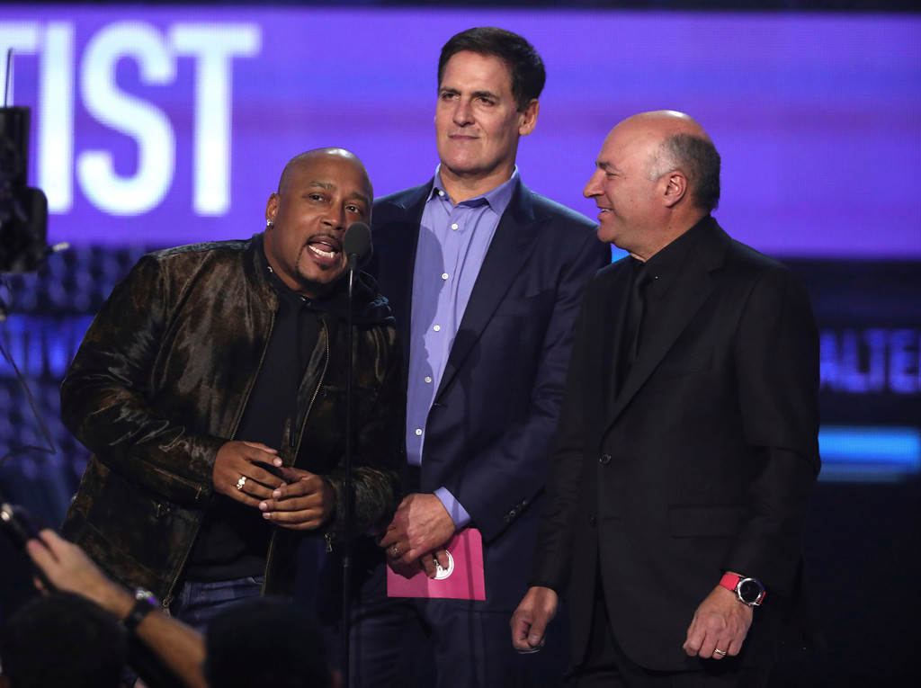 . Daymond John, from left, Mark Cuban, and Kevin O\'Leary present the award for favorite artist alternative rock at the American Music Awards at the Microsoft Theater on Sunday, Nov. 19, 2017, in Los Angeles. (Photo by Matt Sayles/Invision/AP)