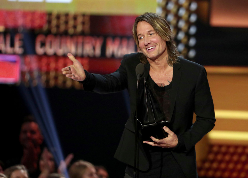 ". Keith Urban accepts the award for favorite male artist country, favorite song country for ""Blue Ain\'t Your Color\"" and favorite album country for \""Ripcord\"" at the American Music Awards at the Microsoft Theater on Sunday, Nov. 19, 2017, in Los Angeles. (Photo by Matt Sayles/Invision/AP)"