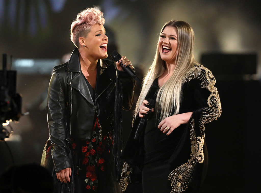 ". Pink, left, and Kelly Clarkson perform ""Everybody Hurts\"" at the American Music Awards at the Microsoft Theater on Sunday, Nov. 19, 2017, in Los Angeles. (Photo by Matt Sayles/Invision/AP)"