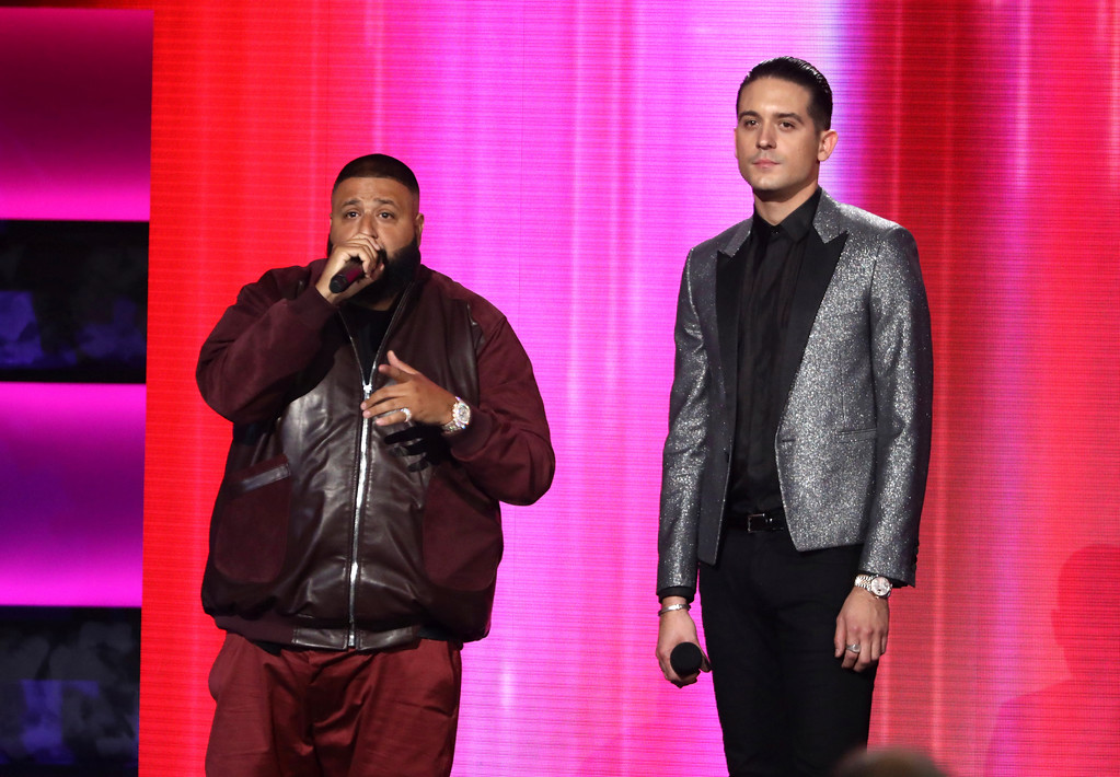 . DJ Khaled, left, and G-Eazy introduce a performance by Macklemore and Skylar Grey at the American Music Awards at the Microsoft Theater on Sunday, Nov. 19, 2017, in Los Angeles. (Photo by Matt Sayles/Invision/AP)