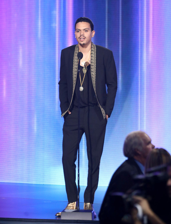 . Evan Ross presents the lifetime achievement award at the American Music Awards at the Microsoft Theater on Sunday, Nov. 19, 2017, in Los Angeles. (Photo by Matt Sayles/Invision/AP)
