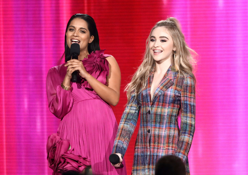 . Lilly Singh, left, and Sabrina Carpenter introduce a performance by Shawn Mendes at the American Music Awards at the Microsoft Theater on Sunday, Nov. 19, 2017, in Los Angeles. (Photo by Matt Sayles/Invision/AP)