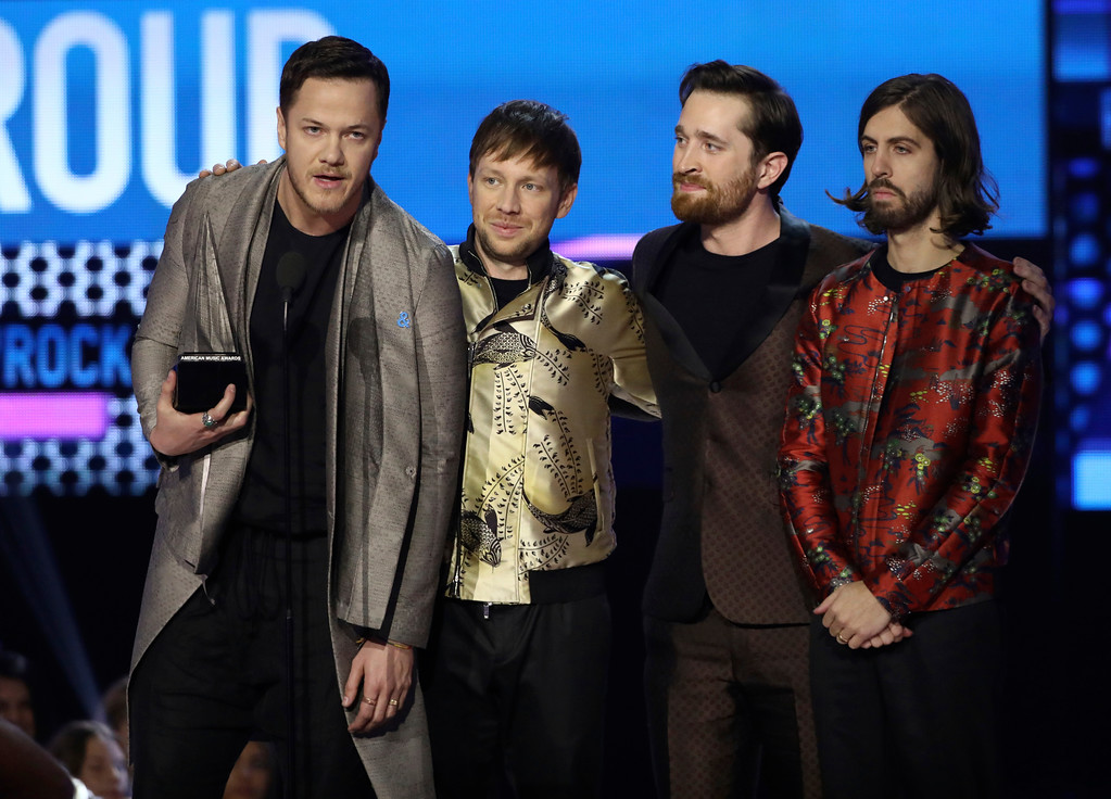 . Dan Reynolds, from left, Ben McKee, Daniel Platzman, and Daniel Wayne Sermon of Imagine Dragons accept the award for favorite duo or group at the American Music Awards at the Microsoft Theater on Sunday, Nov. 19, 2017, in Los Angeles. (Photo by Matt Sayles/Invision/AP)