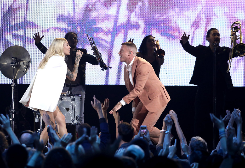 ". Macklemore, right, and Skylar Grey perform ""Glorious\"" at the American Music Awards at the Microsoft Theater on Sunday, Nov. 19, 2017, in Los Angeles. (Photo by Matt Sayles/Invision/AP)"