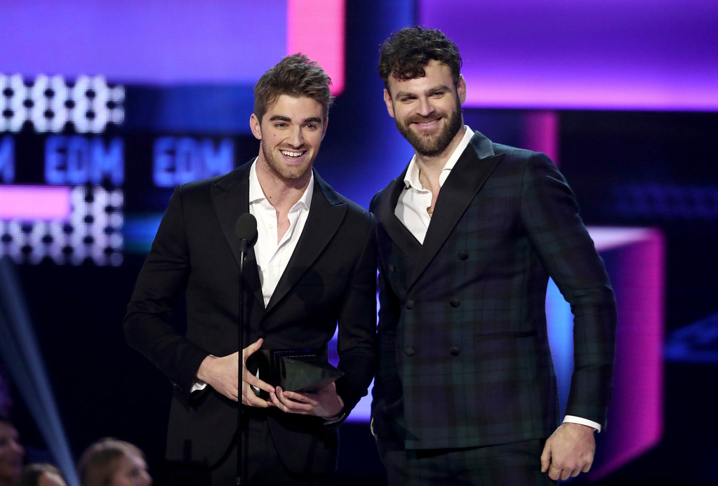 . Andrew Taggart, left, and Alex Pall of The Chainsmokers accept the award for favorite artist electronic dance music at the American Music Awards at the Microsoft Theater on Sunday, Nov. 19, 2017, in Los Angeles. (Photo by Matt Sayles/Invision/AP)