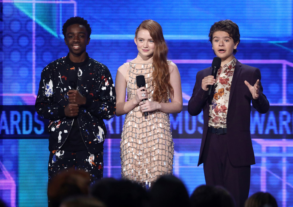 . Kaleb McLoughlin, from left, Sadie Sink, and Gaten Matarazzo introduce a performance by Alessia Cara and Zedd at the American Music Awards at the Microsoft Theater on Sunday, Nov. 19, 2017, in Los Angeles. (Photo by Matt Sayles/Invision/AP)