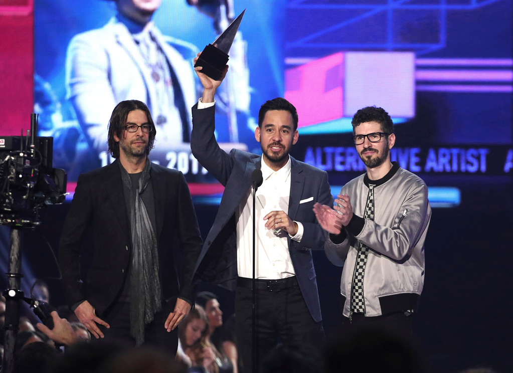 . Rob Bourdon, from left, Mike Shinoda, and Brad Delson of Linkin Park accept the award for favorite artist alternative rock at the American Music Awards at the Microsoft Theater on Sunday, Nov. 19, 2017, in Los Angeles. (Photo by Matt Sayles/Invision/AP)