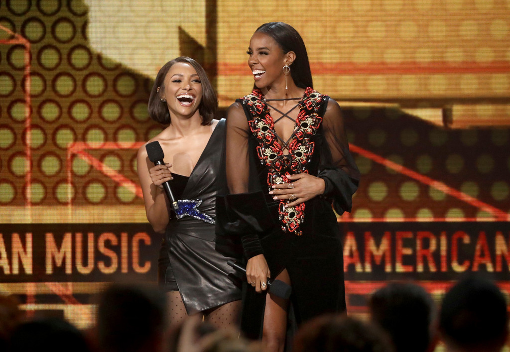 . Kat Graham, left, and Kelly Rowland introduce a performance by Niall Horan at the American Music Awards at the Microsoft Theater on Sunday, Nov. 19, 2017, in Los Angeles. (Photo by Matt Sayles/Invision/AP)