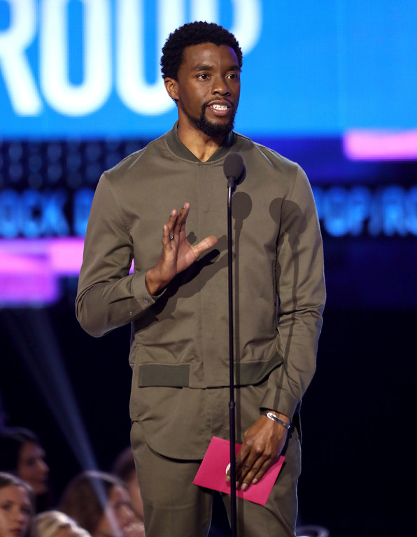 . Chadwick Boseman presents the award for favorite duo or group at the American Music Awards at the Microsoft Theater on Sunday, Nov. 19, 2017, in Los Angeles. (Photo by Matt Sayles/Invision/AP)
