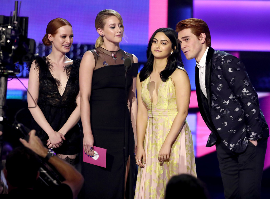. Madelaine Petsch, from left, Lili Reinhart, Camila Mendes, and KJ Apa present the award for favorite artist electronic dance music at the American Music Awards at the Microsoft Theater on Sunday, Nov. 19, 2017, in Los Angeles. (Photo by Matt Sayles/Invision/AP)