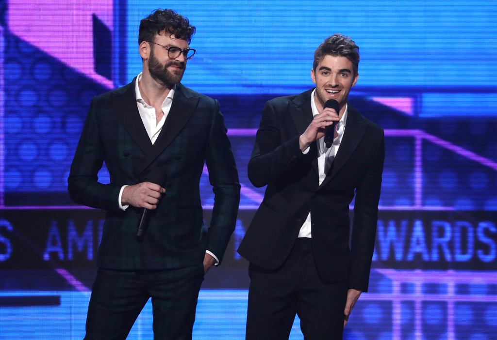 . Alex Pall, left, and Andrew Taggart of The Chainsmokers introduce a performance by BTS at the American Music Awards at the Microsoft Theater on Sunday, Nov. 19, 2017, in Los Angeles. (Photo by Matt Sayles/Invision/AP)