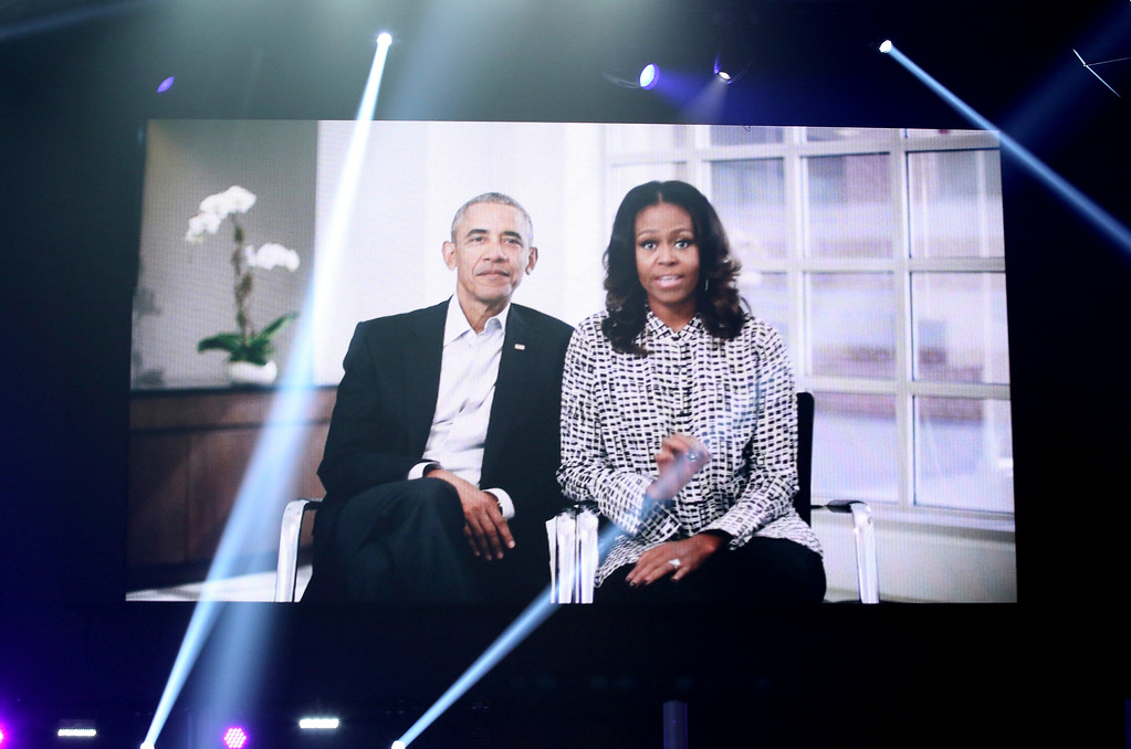 . Former President Barack Obama and Michelle Obama appear on screen before Diana Ross\' performance at the American Music Awards at the Microsoft Theater on Sunday, Nov. 19, 2017, in Los Angeles. (Photo by Matt Sayles/Invision/AP)