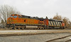 BNSF 4114 - a GE DASH9-44CW, and CN 2419, a GE DASH8-40CM, sit in the Fort Frances yard.