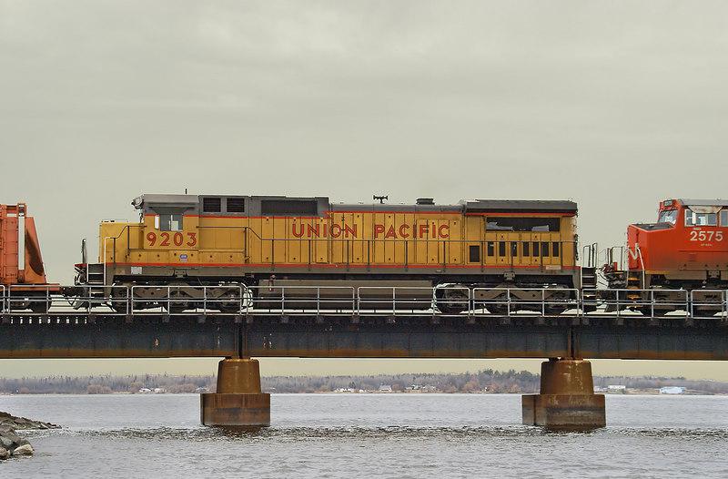 Union Pacific unit 9203, a DASH8-40C crossing the bridge into the United States.