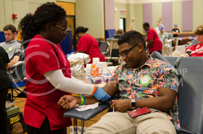 Catara Hardy, a American Red Cross nurse, draws a blood from a volunteer Kevin Thompson during Red Cross fall blood drive at K-State Union on September 25, 2017 (Saya Kakim | Collegian Media Group)