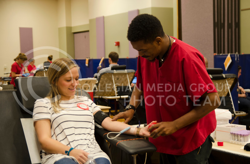 Maurice Winn, a American Red Cross nurse, draws a blood from a volunteer Katie Turner during Red Cross fall blood drive at K-State Union on September 25, 2017 (Saya Kakim | Collegian Media Group)
