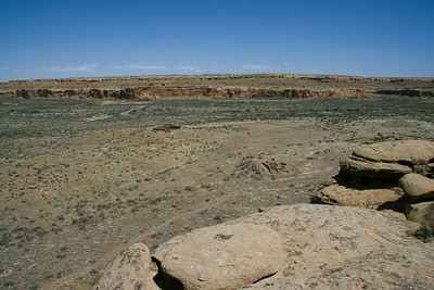 The heart of Chaco Canyon - looking north across the canyon, with small pueblos in foreground, Casa Rinconda in the middle, Pueblo Bonito against far canyon wall, Pueblo Alto as a tiny spot on top of the far mesa in the distance. Chetro Ketl can be seen just to the left of the side canyon to the right on the far side.