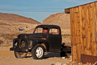black pickup behind Rhyolite Mercantile store