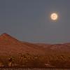 train tracks w moonrise in Mojave Desert