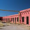ruin of a pink adobe motel Bowie AZ