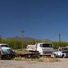 three bright rusty trucks