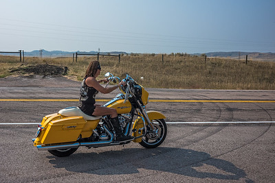 motorcycle mama taking off Spotted Horse WY