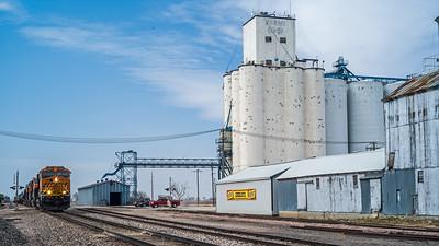 train approaching Friend Co-Op grain elevators