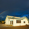 church in Mesilla with rainbow