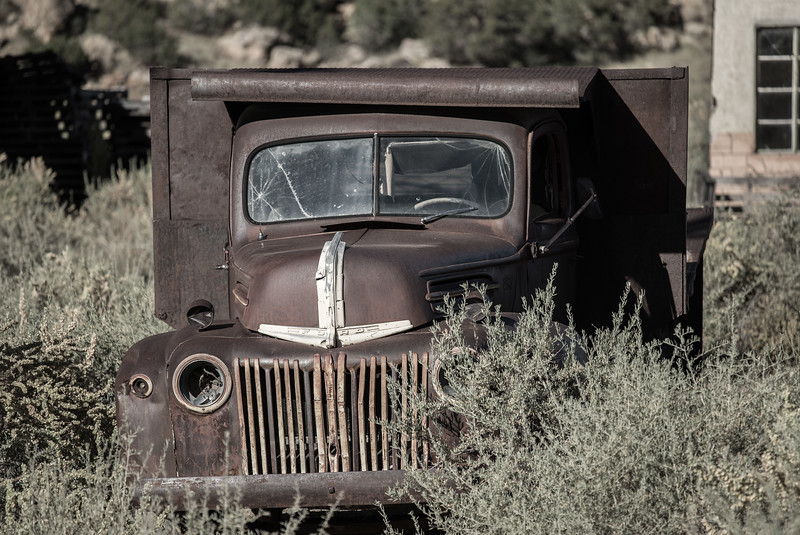 Ford truck rusting outside Budville