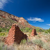 adobe ruins & matching mountain against blue sky